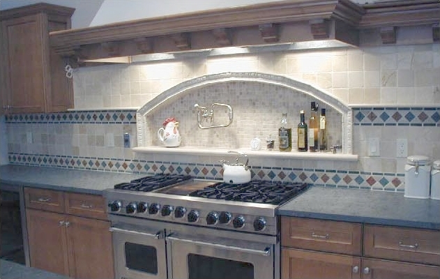 This tumbled marble backsplash is laid straight with double diagonal accent